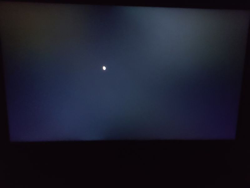 Black screen in dark environment. Taken from straight angle. Backlit keyboard was off.
